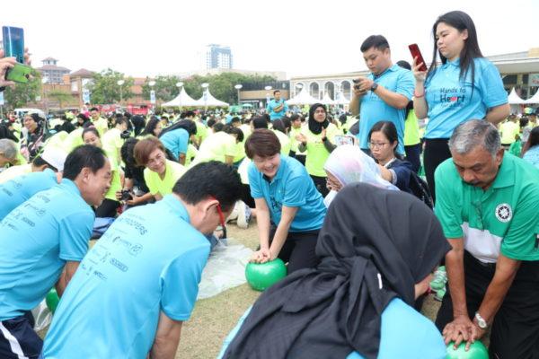VIPs practising CPR